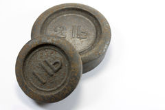 Antique Kitchen 1lb and 2lb Weights. On white background stock photo