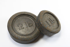 Antique Kitchen 1lb and 2lb Weights. On white background royalty free stock photography