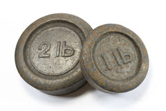 Antique Kitchen 1lb and 2lb Weights. On white background stock photography