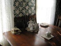 Antique kitchen table setting Stock Photo