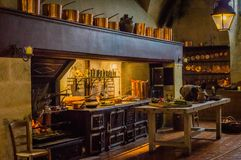 Antique kitchen from the 18th century. With copper saucepans Royalty Free Stock Images