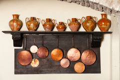 Antique kitchenware. Crockery, pots and amphorae Stock Photos
