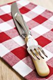 Antique knife and fork on a cloth Stock Images