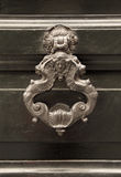 Antique knocker on a door Royalty Free Stock Photo