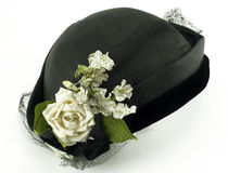 Antique Ladies Hat with Flowers on White. Background, made of straw, velvet and netting Stock Images