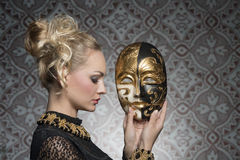 Antique lady with mask Royalty Free Stock Photo
