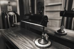Antique lamp on bedside table royalty free stock images