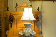 Antique lamp on dresser. A view of a unique, antique lamp on an old, Victorian dry sink or dresser Stock Photo