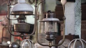 Antique lamp with shade. An old, vintage lamp with a shade in an antique store stock footage