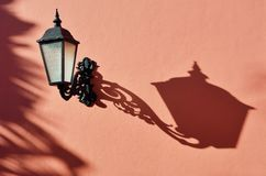 Antique lamp with shadow. And pink wall Royalty Free Stock Image