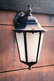 Antique lamp on the stone wall Royalty Free Stock Photos