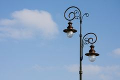 Antique lamppost on blue sky. With some clouds and copy space Stock Photo