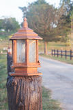 Antique lamppost. Antique Thai style lampost beside the way Royalty Free Stock Photography