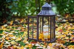 Antique lantern decorated with autumn leaves and candle Stock Image