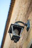 Antique lantern hanging on the wall Stock Photography