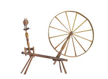 Antique large wheel spinning wheel isolated. stock image