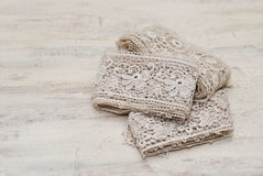Antique lase. Antique handmade lace on the table Stock Photography