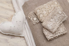 Antique lase. Antique lace, fabric and pin cuscion Stock Photo