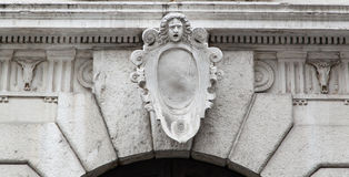 Antique Latin figure at entrance Stock Image