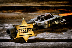 Antique Lawman Sheriff Badge and Western Gun Revolver Stock Photo