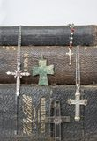 Antique Leather Bibles with Antique and Modern Crosses on White. Collection of crosses from ancient bronze to modern diamond on background of antique leather Stock Photos