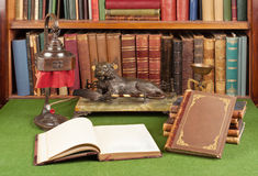 Antique leather books, lamp and reading glasses Royalty Free Stock Photos