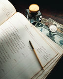 Antique ledger book. With old US currency and coins Stock Photography