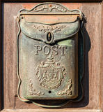 Antique letter box at a wooden door Royalty Free Stock Photo