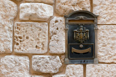 Antique letterbox. Letterbox in ancient Medina stone wall in Malta Stock Images