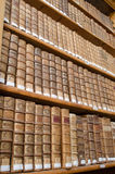 Antique library shelves with old books Stock Images
