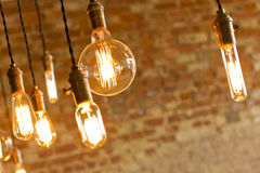 Antique Light Bulbs. Decorative antique edison style light bulbs against brick wall background Stock Images