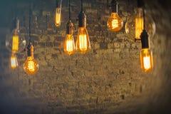 Antique Light Bulbs. Decorative antique edison style light bulbs against brick wall background Stock Image