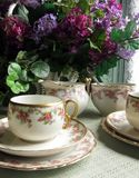 Limoges China. Antique Limoges Bridal Wreath cup, saucer and sandwich/pastry plates with cream and sugar in the background stock image