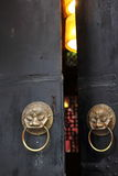 Antique lion head door knob at a Chinese door Stock Photo