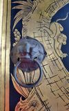 Antique Lion knob and gold monkey painting on temple door Royalty Free Stock Photo
