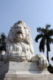 Antique Lion Statue in sky background at Victoria Memorial Gate, Kolkata. India. Built with white Makrana Marbles using the European and the Indo-Islamic style Royalty Free Stock Photo