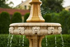 Antique little waterfall in the garden falling drops close-up stock photos