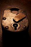 Antique Padlock. Antique wood and metal padlock royalty free stock photo