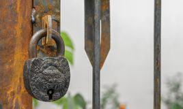 An antique lock on a rusted handle stock images