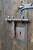 Antique lock with a hasp on the timber entrance Stock Image