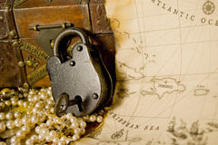 Antique Lock. With key and pirate map Stock Image