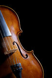 Antique looking violin on black. Close up of an antique looking violin isolated on a black background Royalty Free Stock Image