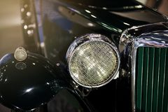 Antique luxury car front headlight. Stock Photography