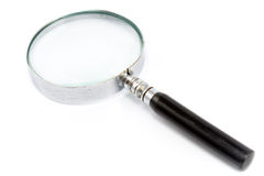 Antique magnifying glass Royalty Free Stock Photography