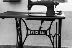 An antique manual `Singer` treadle sewing machine. Black and white Stock Images