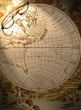 Antique map with old spectacles Stock Photos