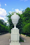 Antique marble amphora on a stone pedestal in the park Royalty Free Stock Image