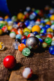 Antique Marble Collection. A collection of colorful glass antique marbles on a wooden background Stock Photography