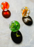 Antique Marble Collection. Three colorful antique glass marbles on a metal background Stock Photo