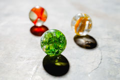 Antique Marble Collection. Three colorful antique glass marbles on a metal background Royalty Free Stock Images